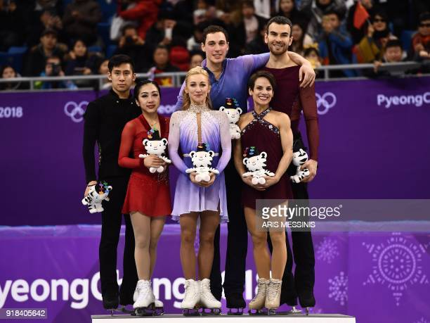 TOPSHOT Gold winners Germany's Aljona Savchenko and Germany's Bruno Massot pose on the podium with silver winners China's Sui Wenjing and China's Han...