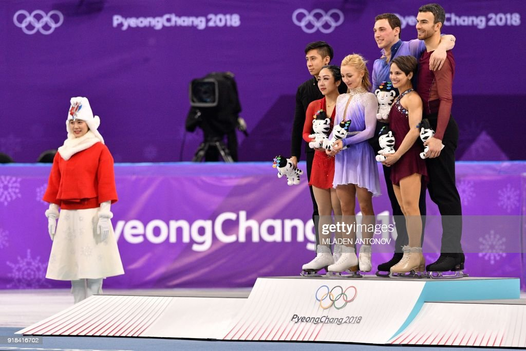 Gold winners Germany's Aljona Savchenko and Germany's Bruno Massot (C) pose on the podium with silver winners China's Sui Wenjing and China's Han Cong (L), and bronze winners Canada's Meagan Duhamel and Canada's Eric Radford (R), during the venue ceremony after the pair skating free skating of the figure skating event during the Pyeongchang 2018 Winter Olympic Games at the Gangneung Ice Arena in Gangneung on February 15, 2018. / AFP PHOTO / Mladen ANTONOV