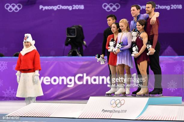 Gold winners Germany's Aljona Savchenko and Germany's Bruno Massot pose on the podium with silver winners China's Sui Wenjing and China's Han Cong...