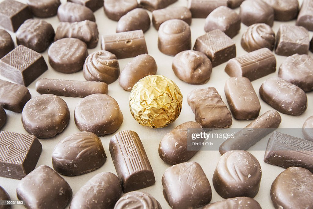 Gold wrapped chocolate amongst cheep ones : Stock Photo