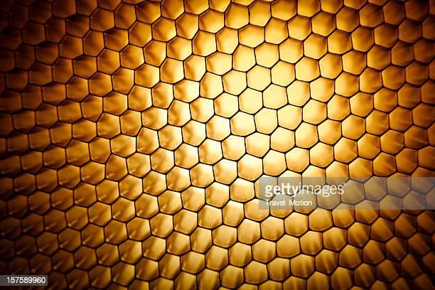 Favo de mel ouro amarelo textura de fundo de grelha de malha