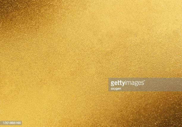 gold yellow sparkling background - gold coloured stock pictures, royalty-free photos & images
