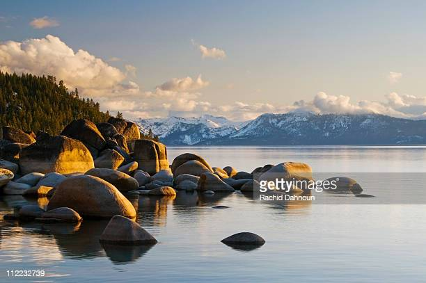 Golden afternoon light illuminates granite boulders on the east shore of Lake Tahoe, NV.