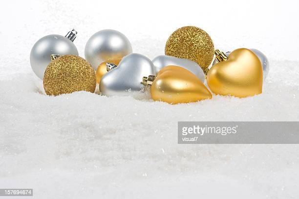 golden and silver baubles with snowflakes - fake snow stock pictures, royalty-free photos & images
