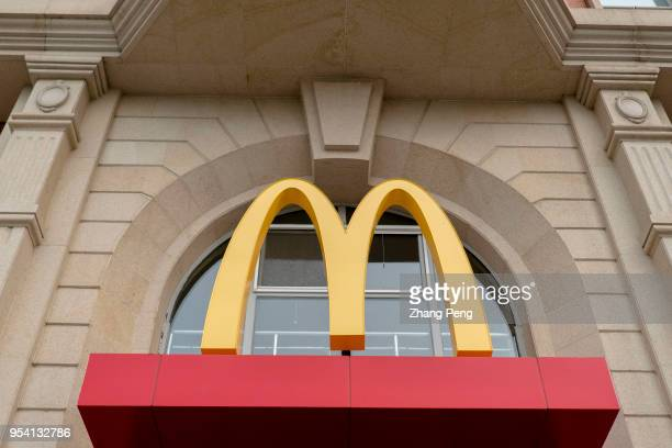 Golden arches logo of McDonald's In the first quarter of 2018 McDonald's profit increased 14% to $138 billion US dollar exceeding market expectations...