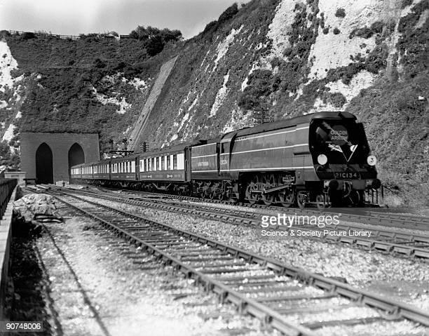 Golden Arrow' cross Channel boat train service, 1948. British Railways West Country Class 4-6-2 steam locomotive No 21C134 leaving Shakespeare Cliff...