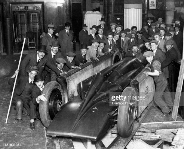 Golden Arrow with crowd of people after unpacking from crate 1929 Creator Unknown