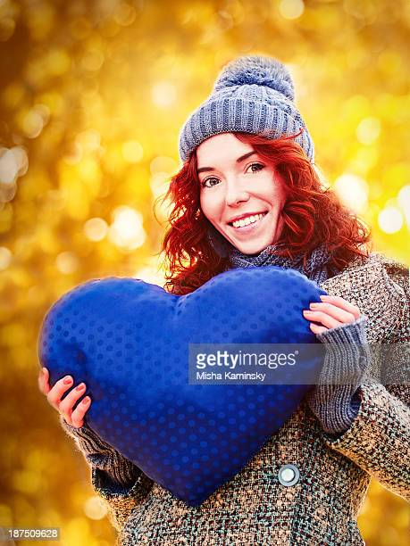 golden autumn portrait of young pretty girl - heart month stock photos and pictures