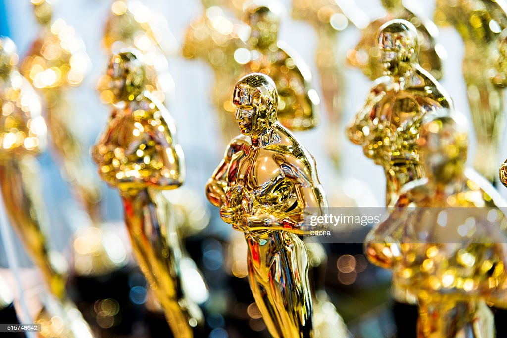 Golden award statues clone : Stock Photo
