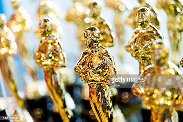 golden award-statuen klon - celebrity fake stock-fotos und bilder