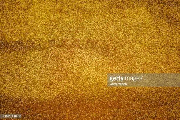 golden background - bronze medalist stock pictures, royalty-free photos & images