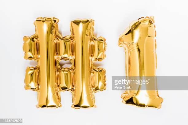 golden #1 balloons - number 1 stock pictures, royalty-free photos & images