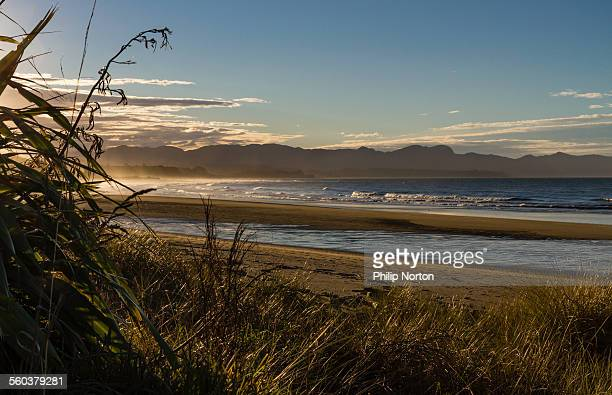 golden bay at dusk - nelson city new zealand stock pictures, royalty-free photos & images