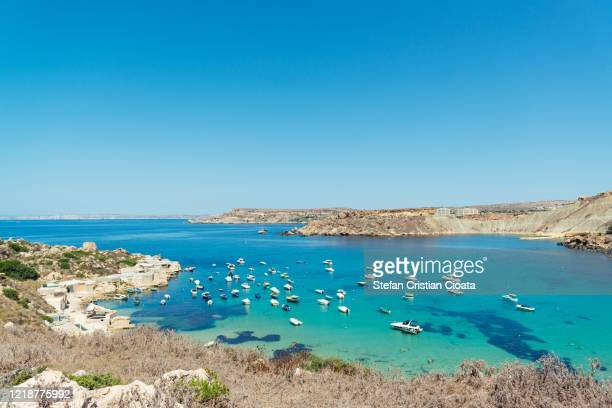 golden bay malta mellieha ir ramla tal mix malta, europe - bay of water stock pictures, royalty-free photos & images