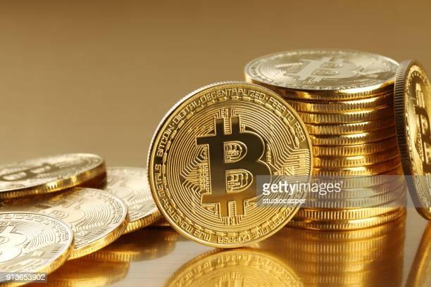 golden bitcoins. new virtual money - bitcoin stock photos and pictures