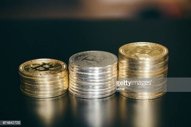 golden bitcoins. new virtual money. - peer to peer stock pictures, royalty-free photos & images