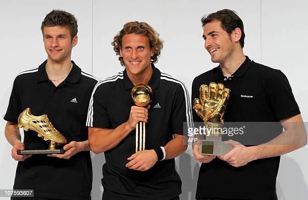 Golden Boot winner Germany's striker Thomas Mueller Golden Ball winner Uruguay's striker Diego Forlan and Golden Glove winner Spain's goalkeeper Iker...