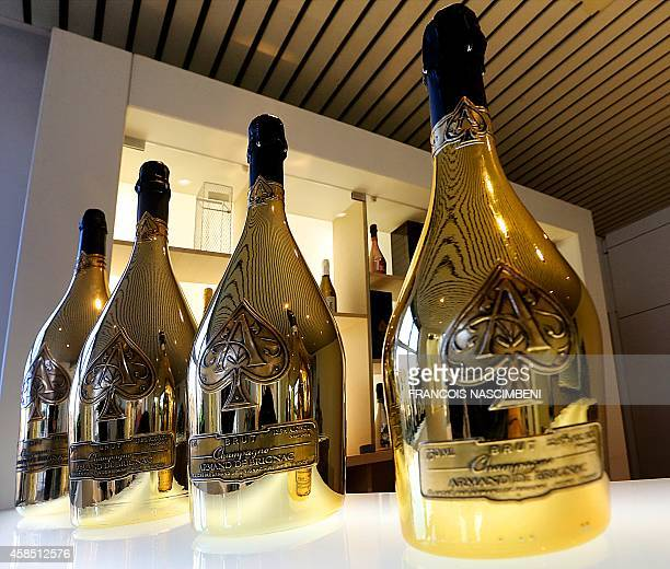 Golden bottles of Armand de Brignac Champagne bearing an aceofspades insignia are seen at the Cattier champagne family house on November 6 2014 in...