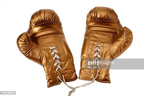 golden boxing gloves on white background - boxing golden gloves stock photos and pictures