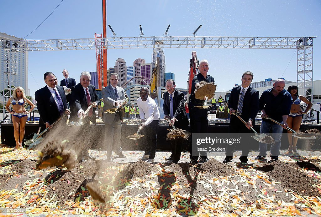 Golden Boy Promotions CEO Richard Schaefer, Clark County Commissioner Steve Sisolak, MGM Resorts International Chairman and CEO Jim Murren, WBC welterweight champion Floyd Mayweather Jr., President and CEO of AEG Dan Beckerman, sportscaster Bill Walton, President of business operations for the Los Angeles Kings Luc Robitaille and UFC President Dana White shovel dirt during a groundbreaking for a USD 375 million, 20,000-seat sports and entertainment arena being built by MGM Resorts International and AEG on May 1, 2014 in Las Vegas, Nevada. The arena is scheduled to open in early 2016.