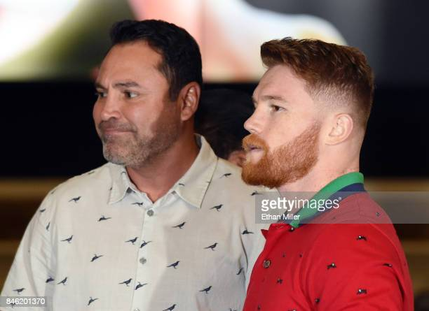 Golden Boy Promotions Chairman and CEO Oscar De La Hoya looks on as boxer Canelo Alvarez arrives at MGM Grand Hotel & Casino on September 12, 2017 in...