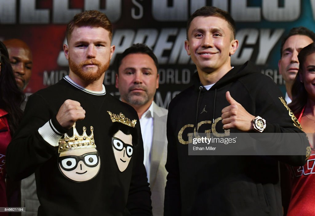 Golden Boy Promotions Chairman and CEO Oscar De La Hoya (C) looks on as Canelo Alvarez (L) and WBC, WBA and IBF middleweight champion Gennady Golovkin pose during a news conference at MGM Grand Hotel & Casino on September 12, 2017 in Las Vegas, Nevada. Golovkin will defend his titles against Alvarez at T-Mobile Arena on September 16 in Las Vegas.