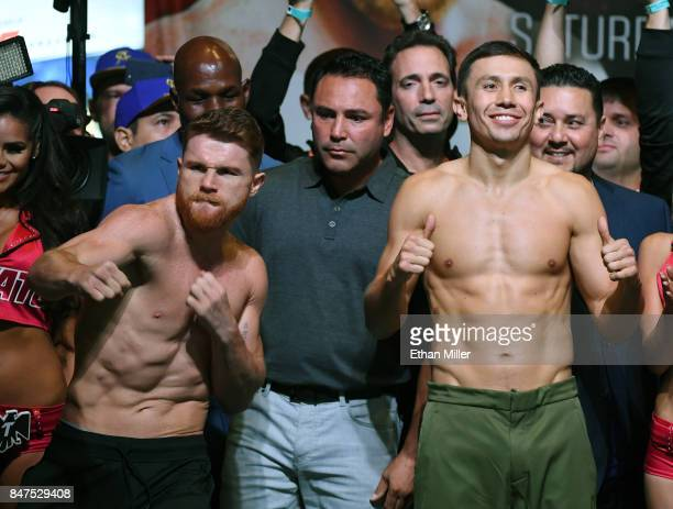 Golden Boy Promotions Chairman and CEO Oscar De La Hoya looks on as Boxer Canelo Alvarez and WBC WBA and IBF middleweight champion Gennady Golovkin...