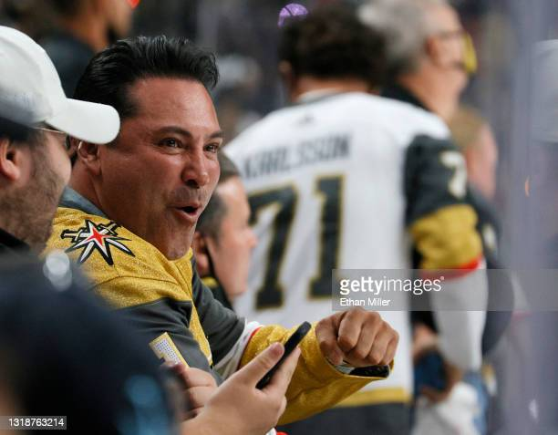 Golden Boy Promotions Chairman and CEO Oscar De La Hoya reacts after Alex Tuch of the Vegas Golden Knights scored a second-period goal against the...