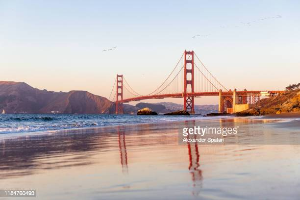 golden bridge and baker beach in san francisco, california - kalifornien stock-fotos und bilder