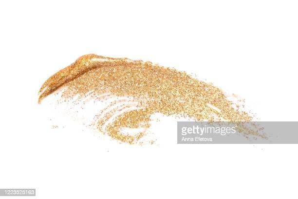 golden brushstroke of cosmetics - 舞台化粧 ストックフォトと画像