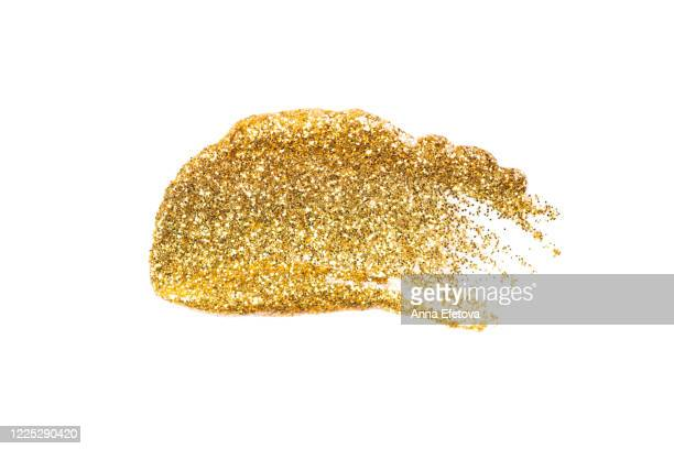golden brushstroke of cosmetics - lip gloss stock pictures, royalty-free photos & images
