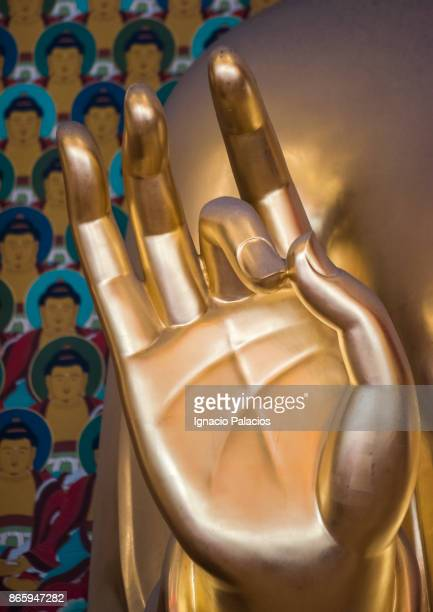 Golden Buddha hand detail at Jogyesa Temple in Seoul, South Korea
