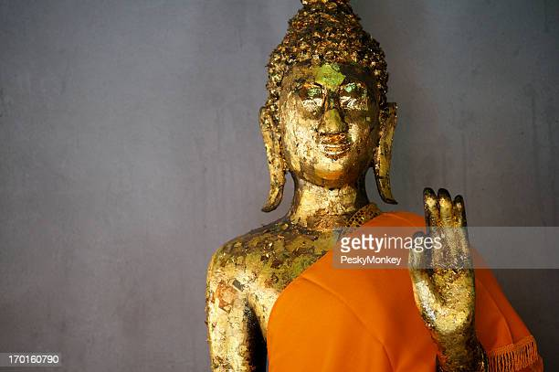 Golden Buddha Holds His Hand Up with Saffron Robe