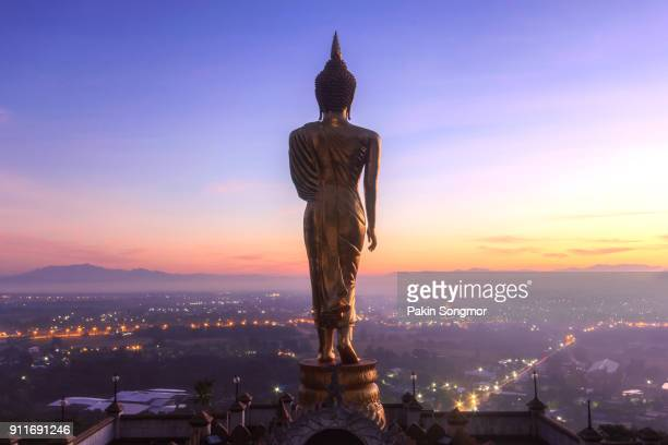 golden buddha statue in khao noi temple at sunrise time - bangkok province stock pictures, royalty-free photos & images