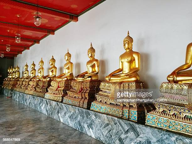 golden buddha statue in row at wat po temple - wat pho stock pictures, royalty-free photos & images