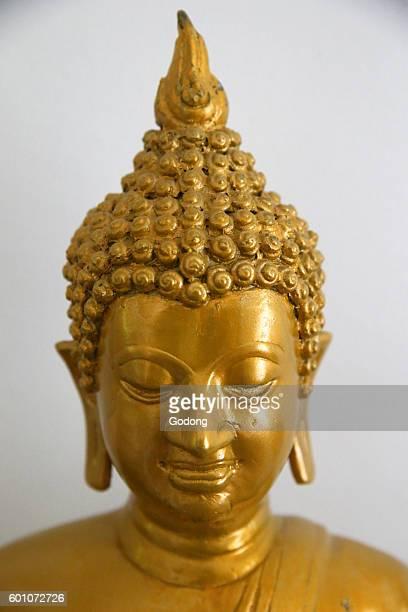 Golden Buddha statue Switzerland