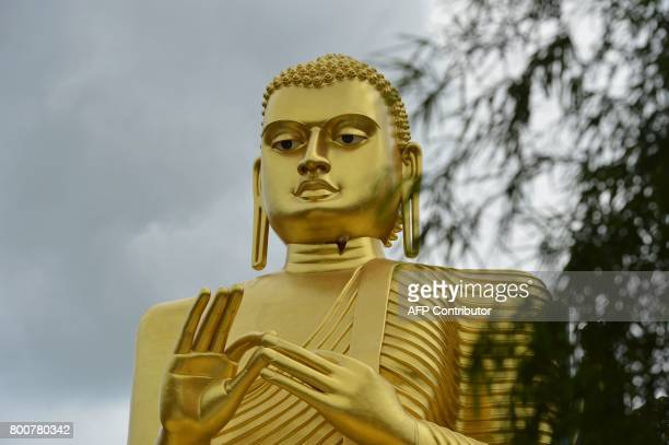 A Golden Buddha statue towers at the Rock Temple also known as the Rangiri Dambulla Rajamaha Viharaya in Dambulla some 150 kms north of Colombo on...