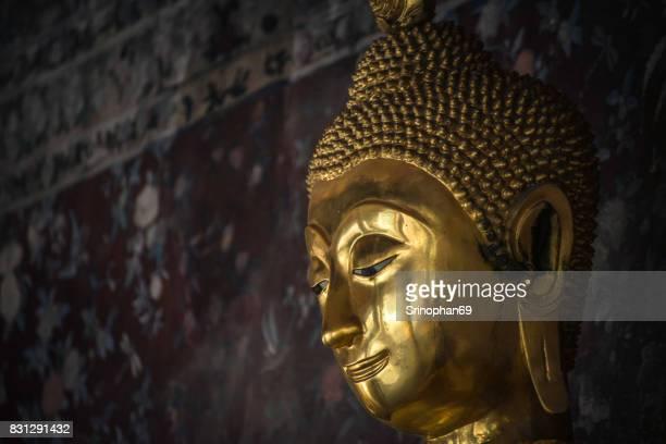 Golden buddha statue Wat Suthat Thailand. - selective focus point