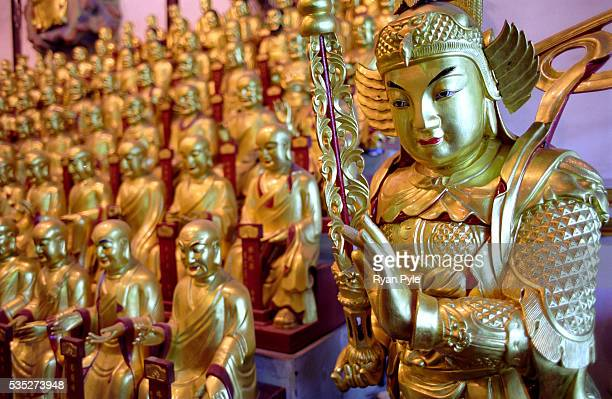 Golden Buddha Statues at the Longhua Temple Shanghai is China's largest and most dynamic city It's modern and ever changing and it seems to be a...