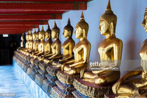 golden buddha statues in wat pho - wat pho stock pictures, royalty-free photos & images