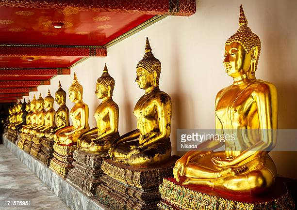 golden buddha statues - wat pho stock pictures, royalty-free photos & images