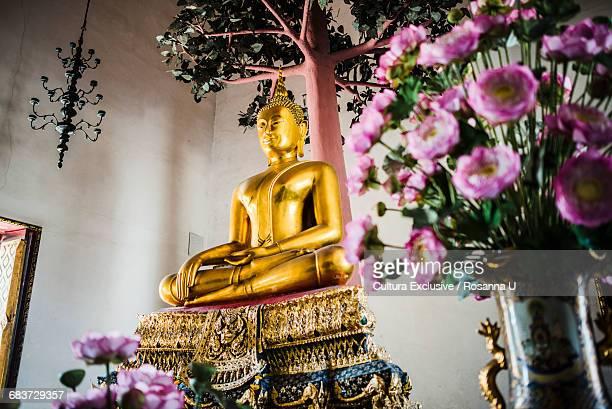 Golden buddhist sculpture, Temple of Reclining Buddha, Bangkok, Thailand