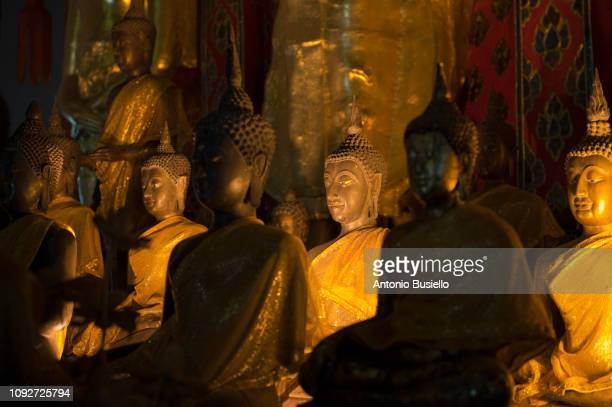 golden buddhist statues - religious event stock pictures, royalty-free photos & images