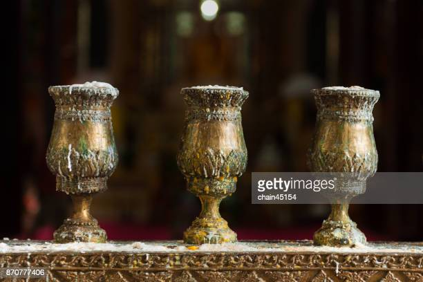Golden candlestick in temple for buddhism blessing to Buddha.