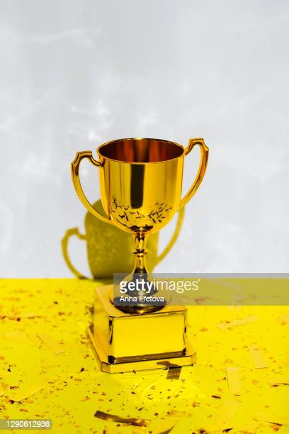 golden champions cup. trendy colors of 2021 year - championships stock pictures, royalty-free photos & images