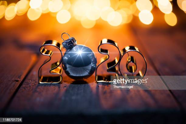 golden christmas 2020 - gold metal lights wood new year - country christmas stock pictures, royalty-free photos & images