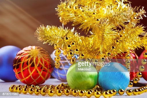 Golden Christmas Tree With Decorated Balls And Light Beams