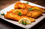 Golden cod filets, garnished with lemon slices