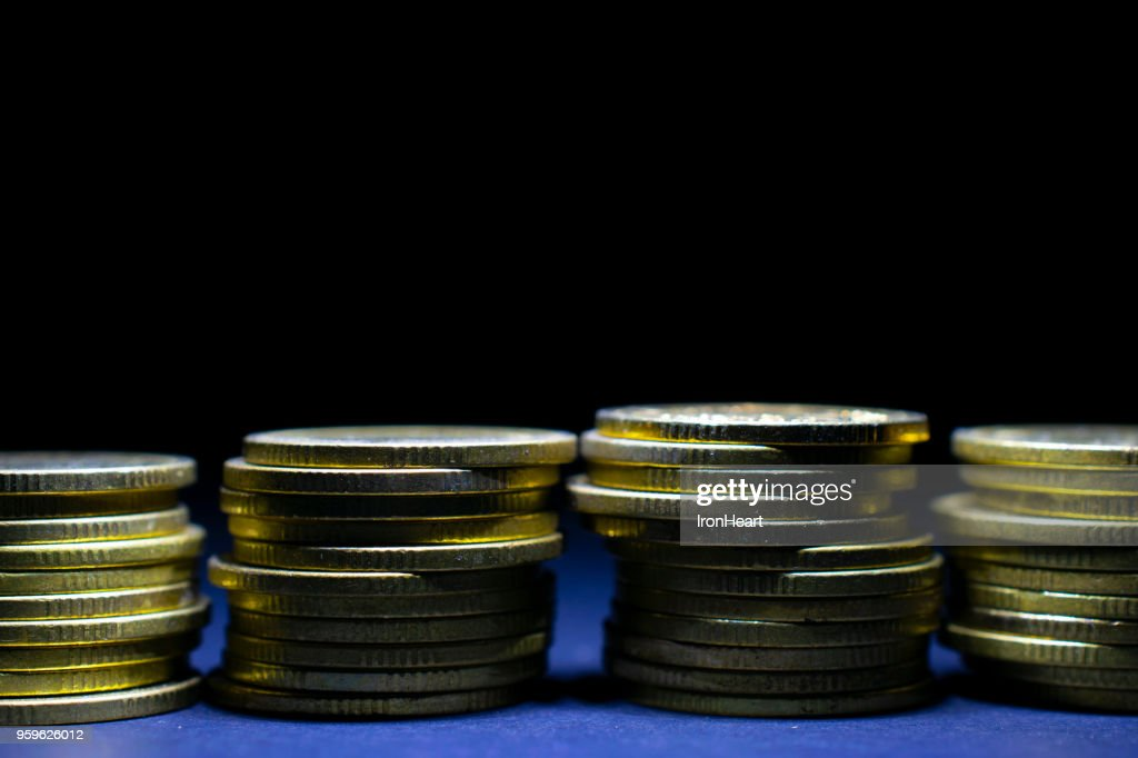 Golden coins with black empty space on top. : Stock-Foto