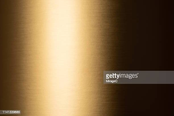 golden colored shiny texture - gold metal stock pictures, royalty-free photos & images
